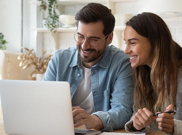 bigstock-Smiling-young-couple-making-sh-327059656_0001_bigstock-Happy-Young-Couple-Paying-Bill-336782710